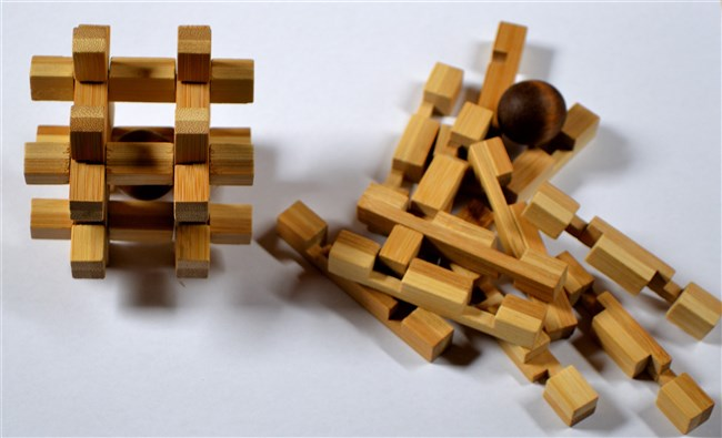The Imprisoned Ball - Bamboo IQ Puzzle